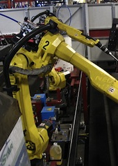 Industrial welding robot. (Credit: Phasmatisnox - Wikipedia)