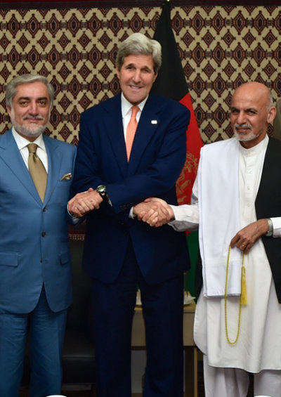 U.S. Secretary of State John Kerry shakes hands with Afghan presidential candidates Abdullah Abdullah and Ashraf Ghani. (Credit: U.S. Department of State - Flickr.com)
